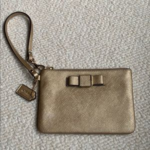 Coach gold metallic wristlet with bow nwot